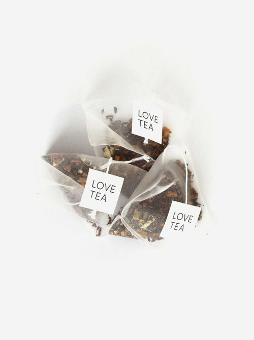 Three tea bags with Love Tea tabs