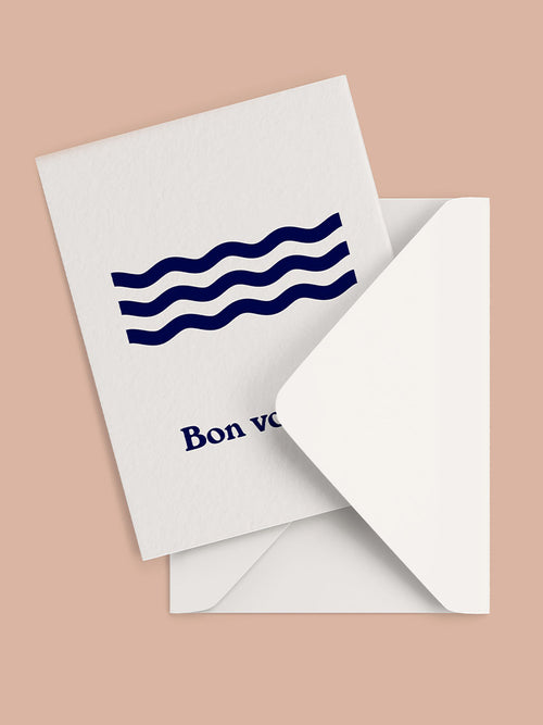 Greeting card with Bon Voyage and waves graphic on the front with white envelope