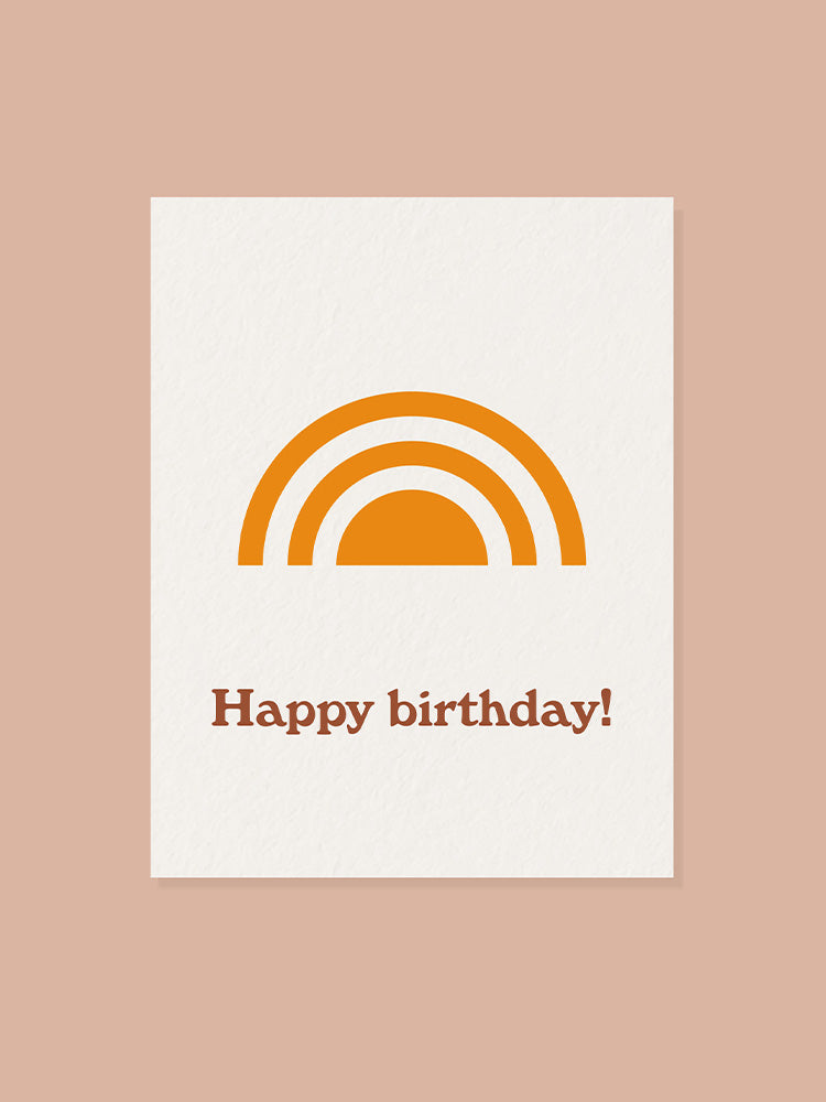 Happy birthday greeting card with yellow rainbow graphic