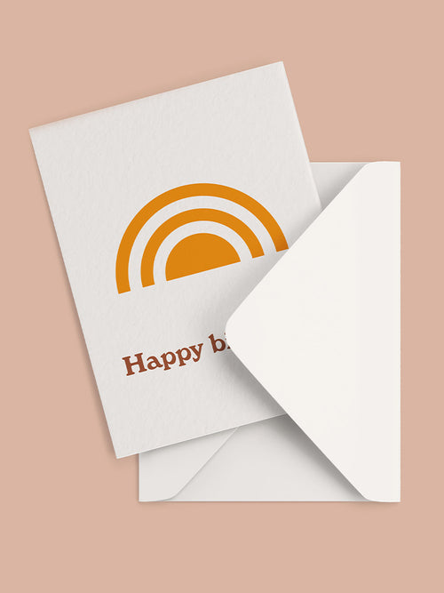 Happy birthday greeting card with yellow rainbow graphic and white envelope
