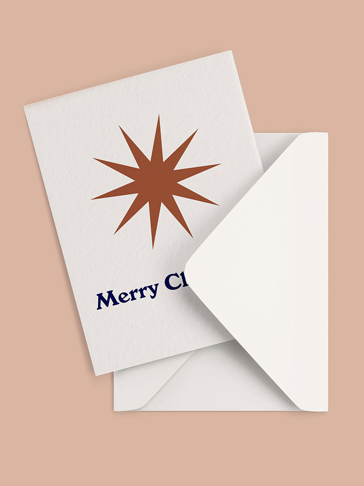 Merry Christmas greeting card with bronze star graphic and white envelope