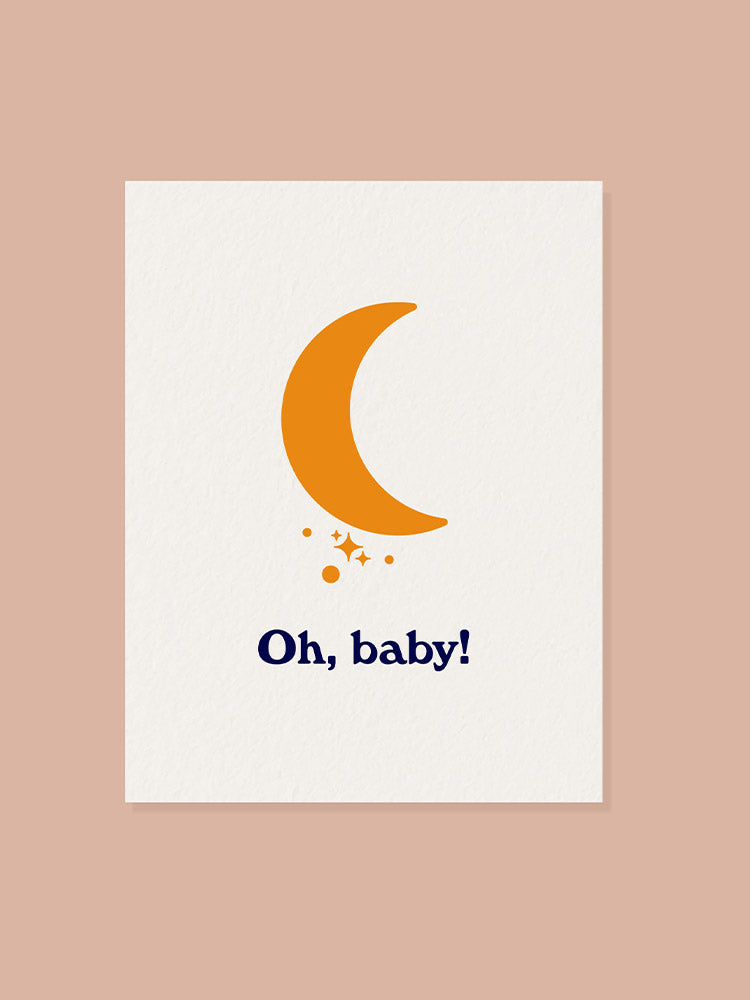 Orange moon graphic on the font of a new baby greeting card