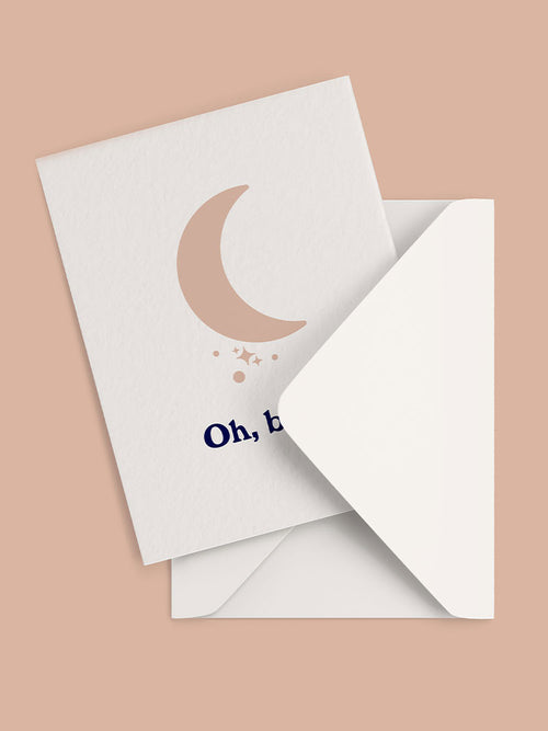 Greeting card with pink moon graphic and Oh Baby Text and white envelope