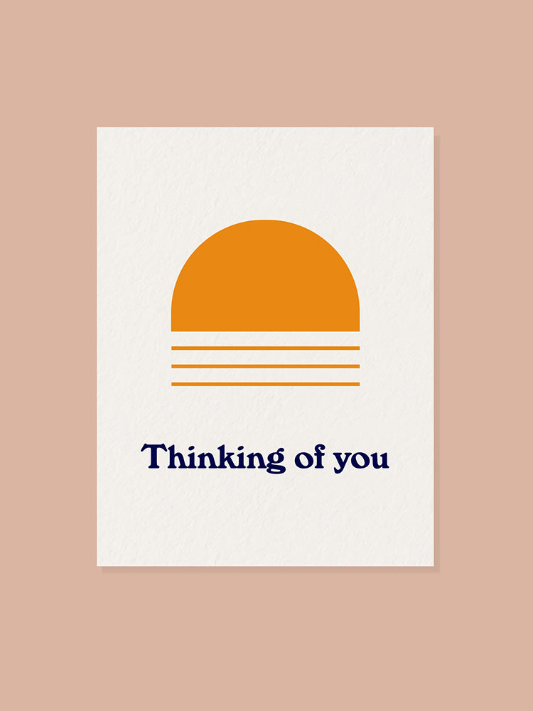 Greeting card with orange arch graphic and thinking of you text