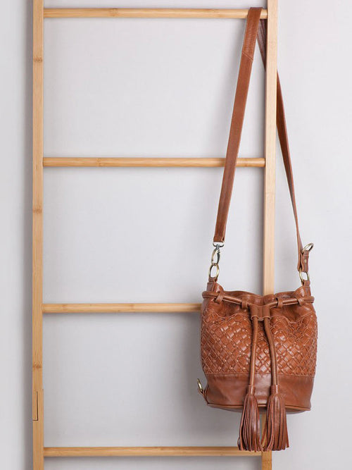 Ovae Valentina bag hanging from decorative ladder