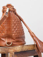 Cross-hatched brown leather hand bag by Ovae