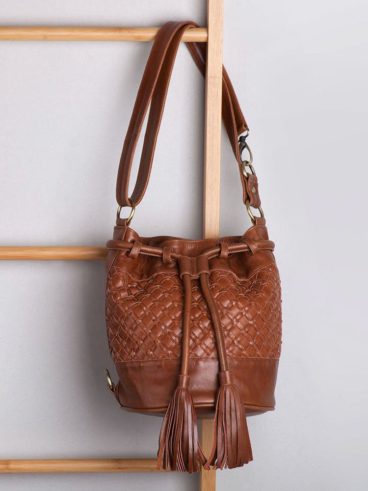 Brown leather bucket bag with matching tassles