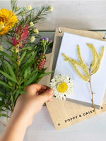 A selection of yellow flowers on wooden flower press