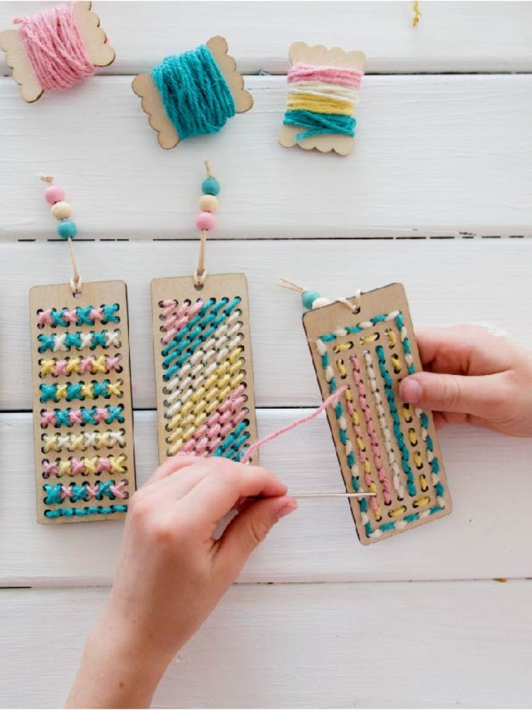 Handmade wooden bookmarks with organic cotton