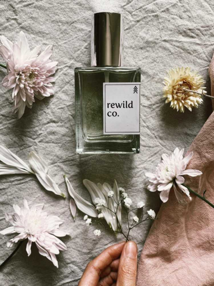 beautiful=bottle-of-rewild-co-perfume-surrounded-by-florals