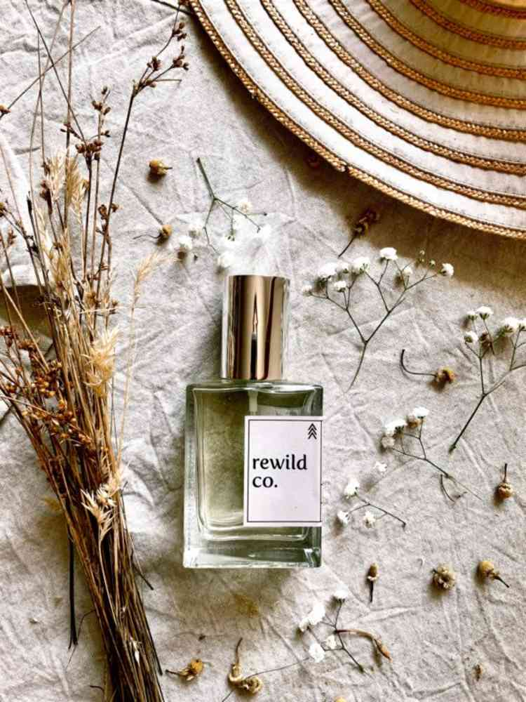 bottle-of-natural-perfume-surrounded-by-dried-botanicals