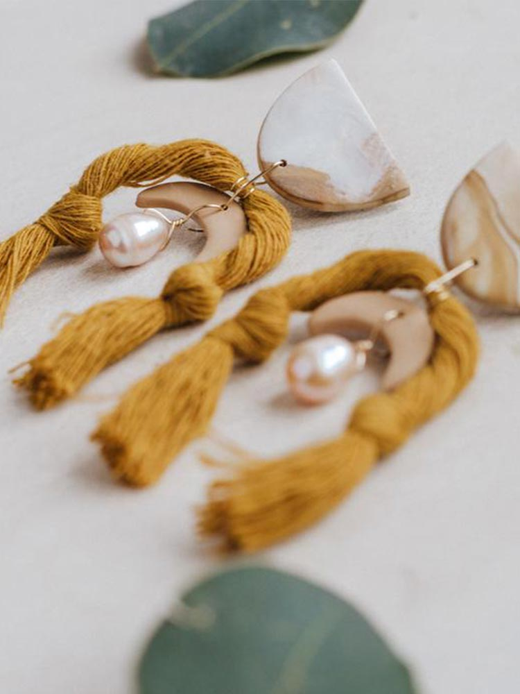 Semi circle white and pink earrings, with a dropped crescent, a drop pearl and mustard rope tassles