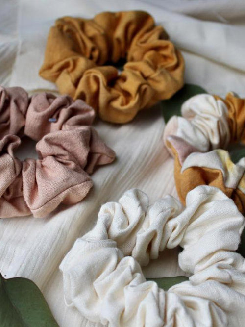 4 Siren and Stone cotton scrunchies on a white sheet