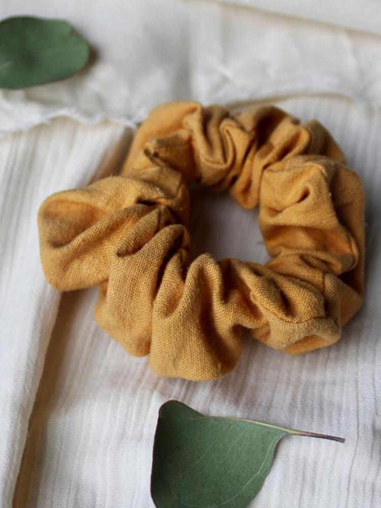 Siren and Stone thick cotton scrunchie in a deep marigold colour
