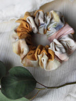 Siren and Stone thick cotton scrunchie in marbled marigold, dusty pink and dreamy blue watercolours