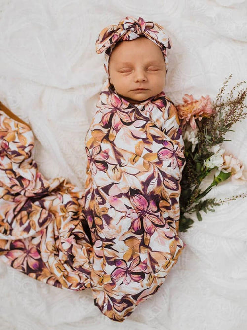 Baby sleeps in Snuggle Hunny Kids Leilani Jersey Wrap & Topknot