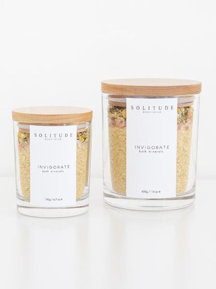 two-pretty-reusable-glass-vessels-containing-organic-bath-salts-and-petals