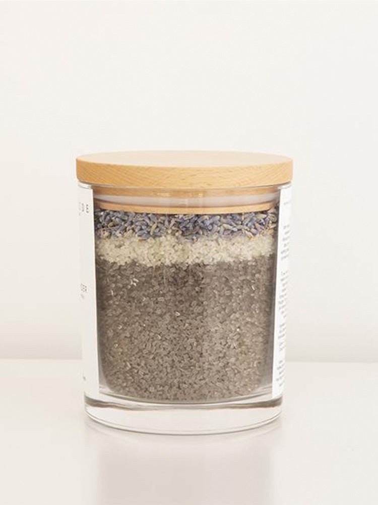 two-glass-jars-filled-with-organic-salts-and-petals