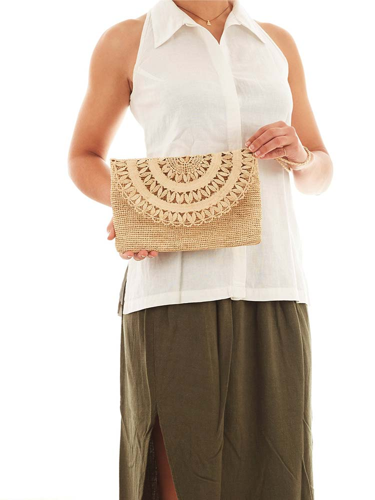 Woman carries the Tanora Boka clutch