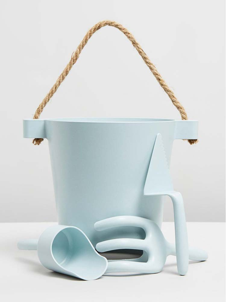 Pale blue kids beach bucket with matching tools