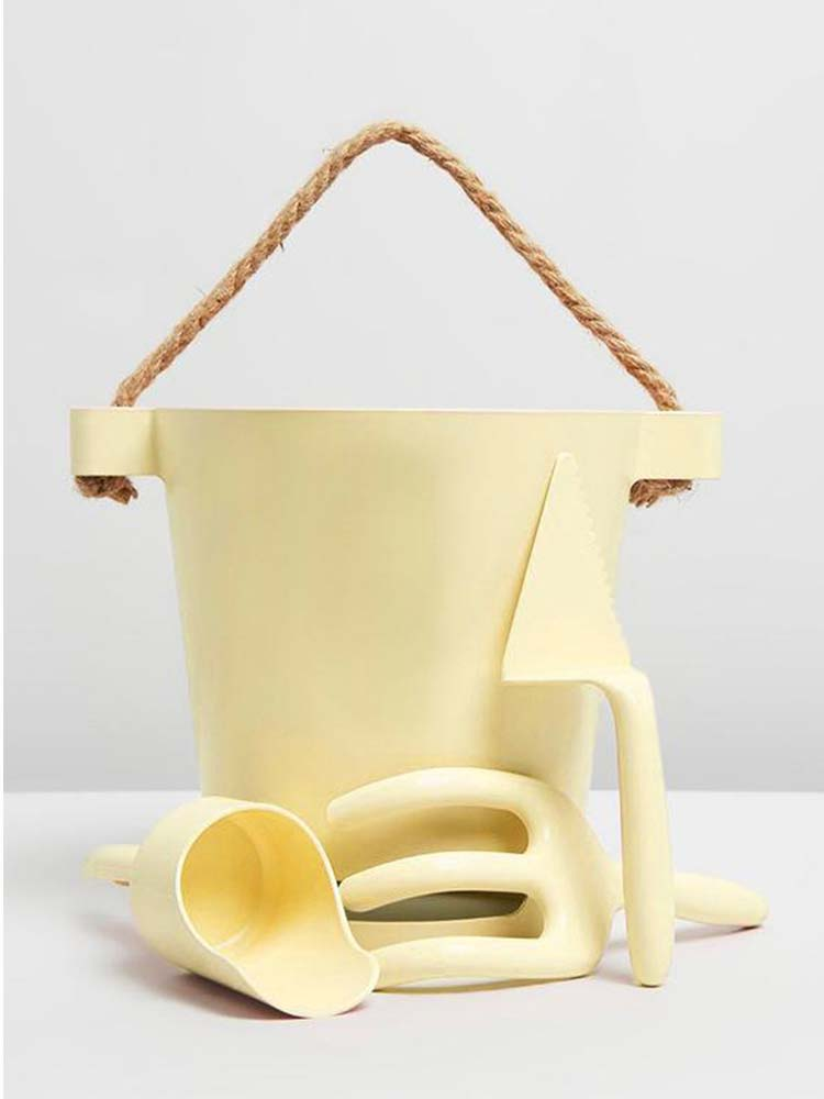 Pale yellow beach bucket with matching tools