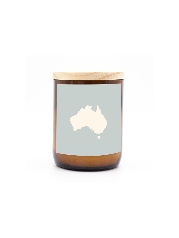 Recycled wine bottle candle with a sticker featuring Australia and a wooden lid