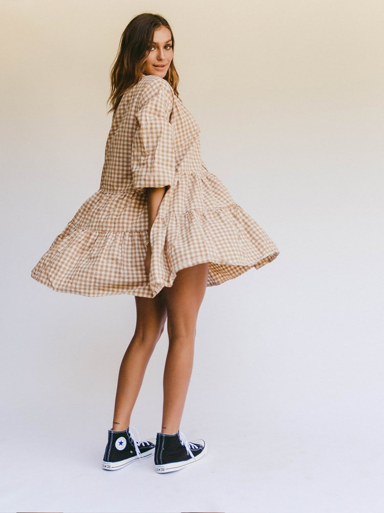 Lady spinning with checked smock dress