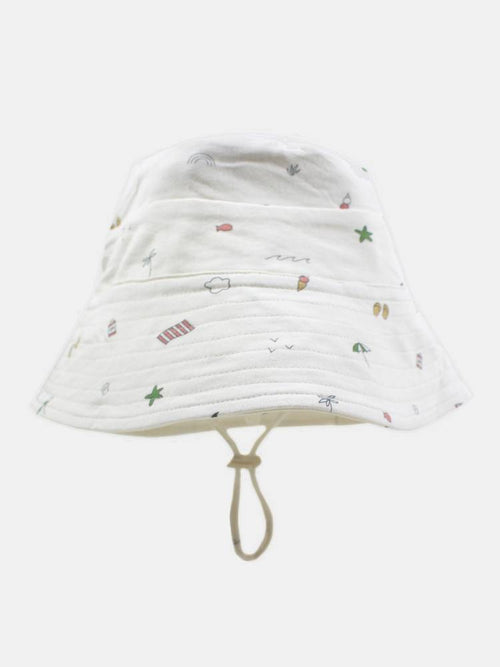 flat lay of beach sunhat by rest