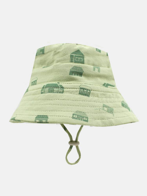 Professional photo of a green hat with houses on it
