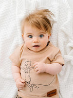 Baby wears the Sky Catcher Tee in oat by Wild Island Apparel