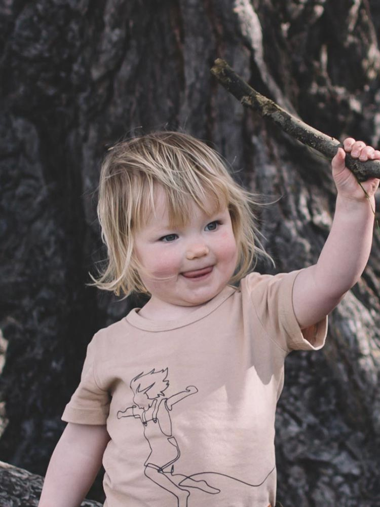 Young girl wears the Sky Catcher Tee in oat by Wild Island Apparel