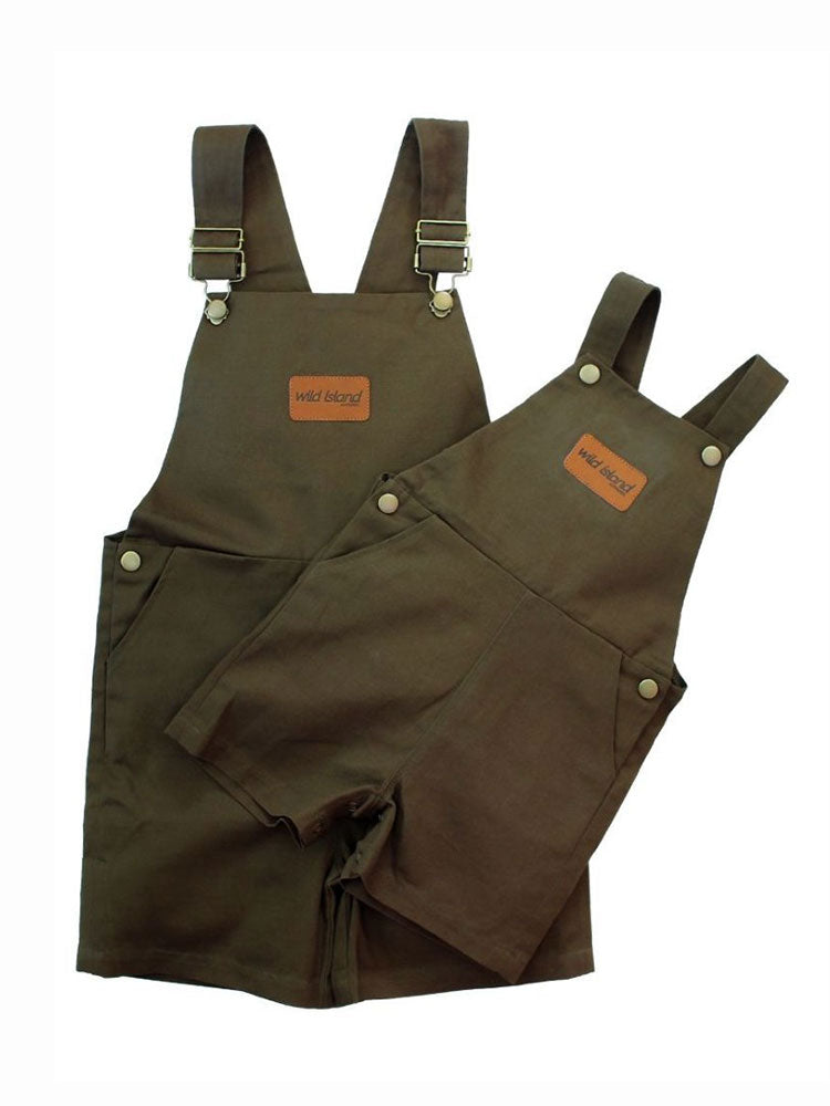 Olive coloured kids overalls with brass fittings and brown leather logo patch