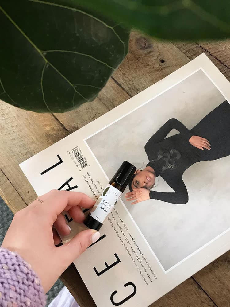Willelaine Aromatherapy Calm Roll On against a trendy magazine