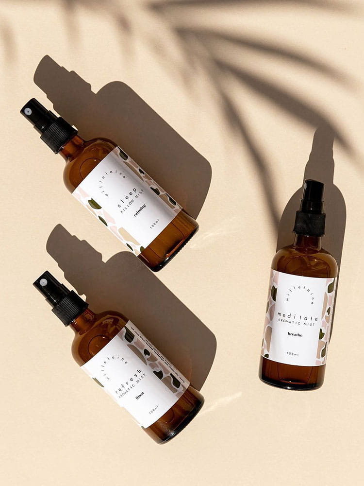 Willelaine Aromatherapy Mist Collection with palm tree shadow