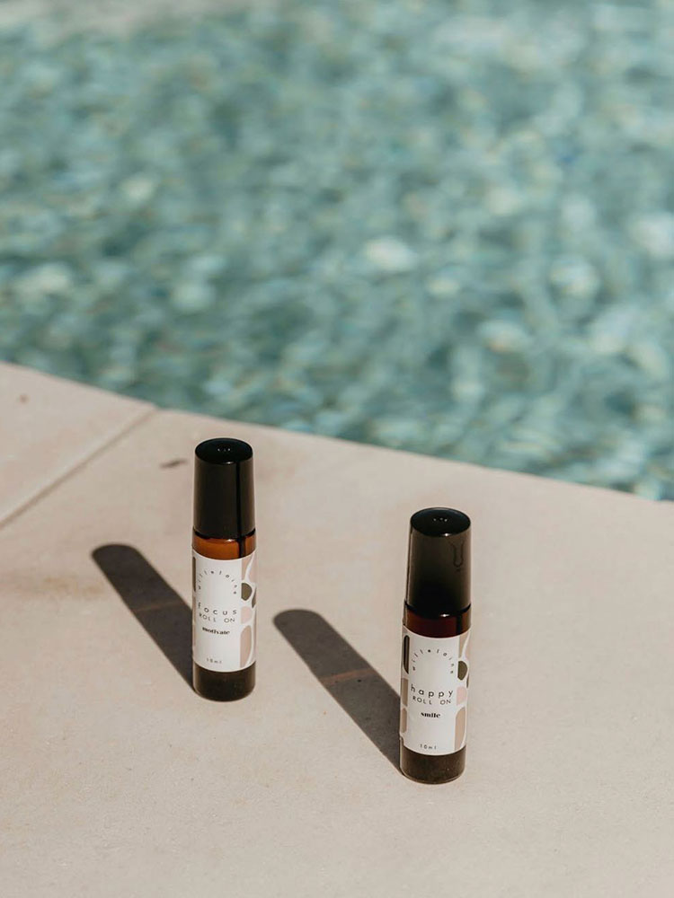 Willelaine Aromatherapy Roll Ons next to a shimmering pool