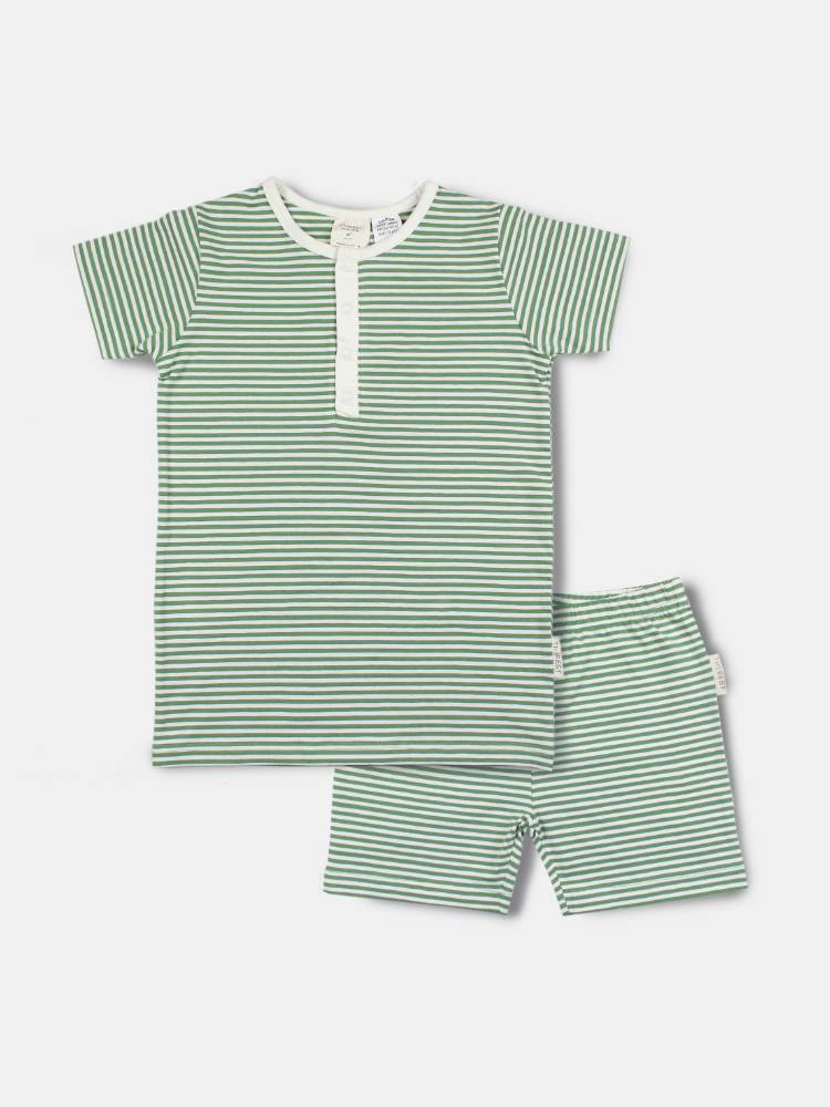 Professional flat lay of green and white striped pajamas