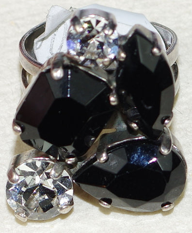 "MARIANA RING CHECKMATE: clear, black stones in 1"" silver setting, adjustable size band"