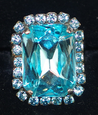 "MARIANA RING AQUAMARINE: blue stones in 7/8"" silver setting, adjustable size band"