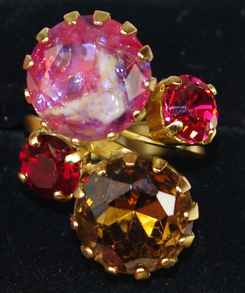 "MARIANA RING: red, pink, brown stones in 1.25"" yellow gold setting, adjustable size band"