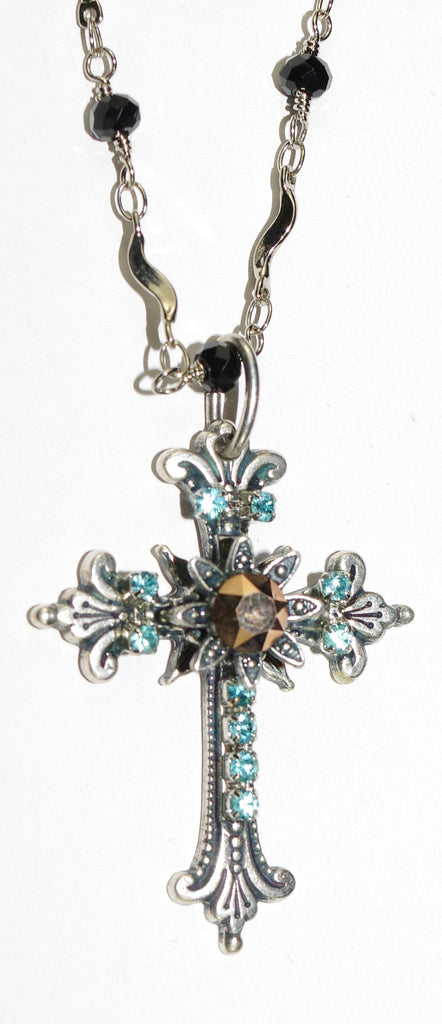 "MARIANA CROSS PENDANT BLUE SUEDE SHOES: gold, blue stones in silver setting, 20"" black beaded adjustable chain"