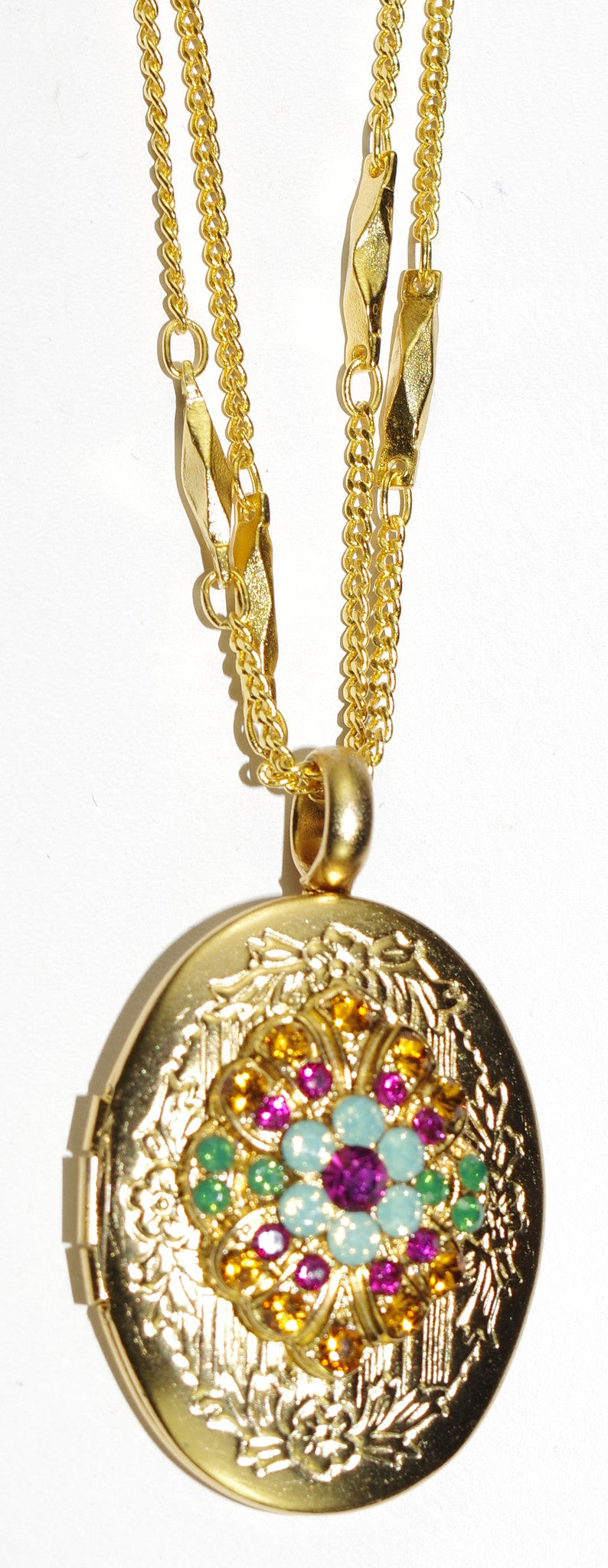 "MARIANA PENDANT LOCKET HAPPY DAYS:  blue, amber, pink stones in 1"" locket in yellow gold setting, 19"" adjustable chain"