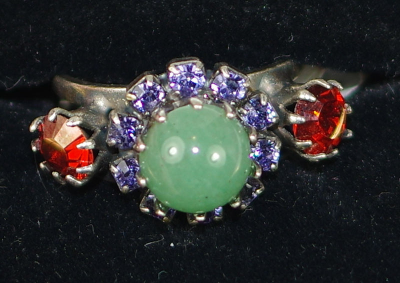 "MARIANA RING IMAGINE: orange, pacific opal, purple stones, center stone = 1/2"" in silver setting, adjustable size band"