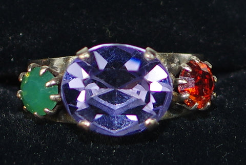 "MARIANA RING IMAGINE: orange, green, purple stones, center stone = 1/2"" in silver setting, adjustable size band"