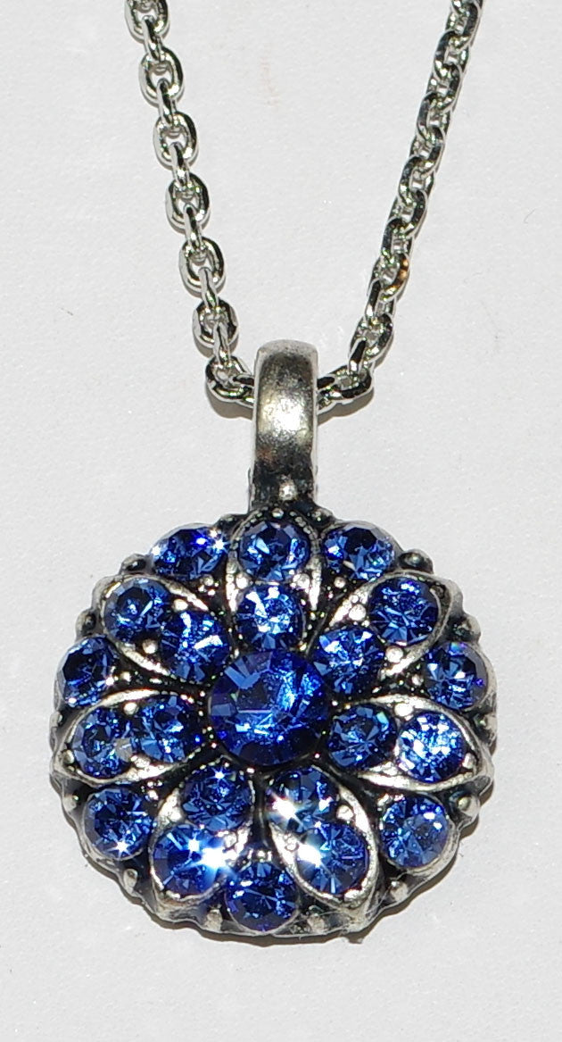 "MARIANA ANGEL PENDANT SAPPHIRE SEPTEMBER BIRTHDAY: blue stones in silver setting, 18"" adjustable chain"