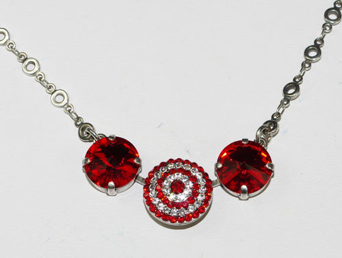 "MARIANA NECKLACE RED: red, clear stones in silver setting, center stone = 5/8"",  20"" adjustable chain"