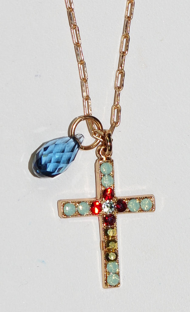 "MARIANA CROSS PENDANT DYNASTY: red, green, gold stones in 1"" rose gold setting, 18"" adjustable chain"
