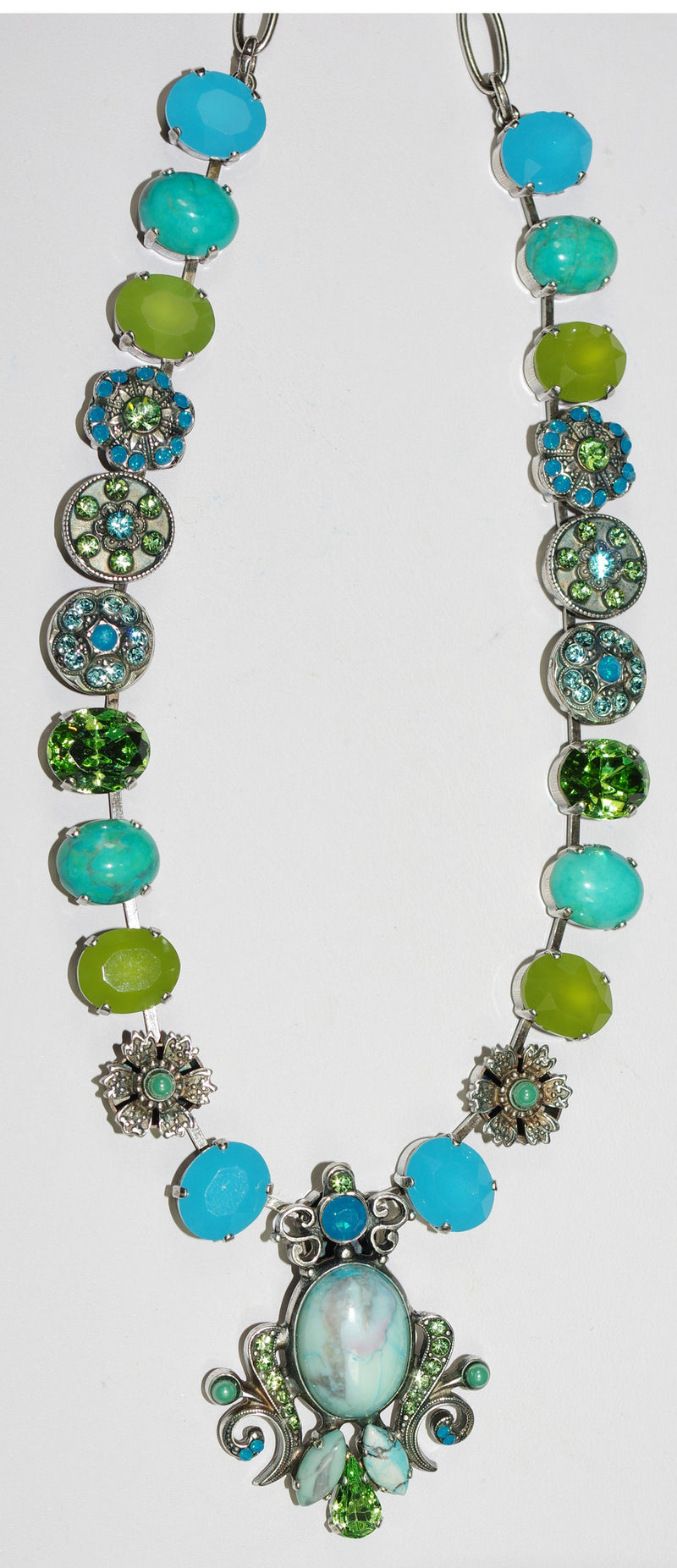 "MARIANA NECKLACE CAPRIOSKA: green, blue stones in silver setting, center pendant = 1.75"", 22"" adjustable chain"