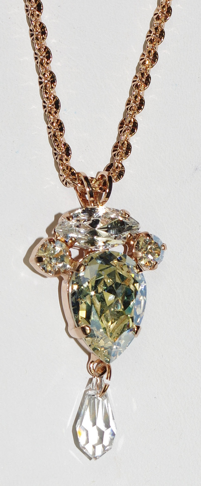 "MARIANA PENDANT ON A CLEAR DAY: clear stones in rose gold setting, center pendant = 2"", 20"" adjustable chain"