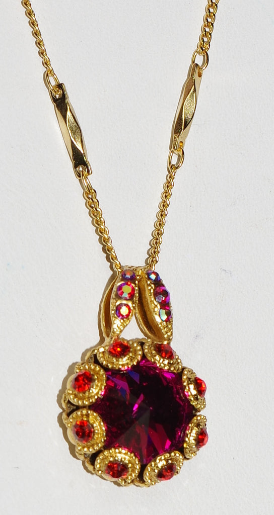 "MARIANA PENDANT LADY MARMALADE: pink, orange stones in 1"" yellow gold setting, 18"" adjustable chain"