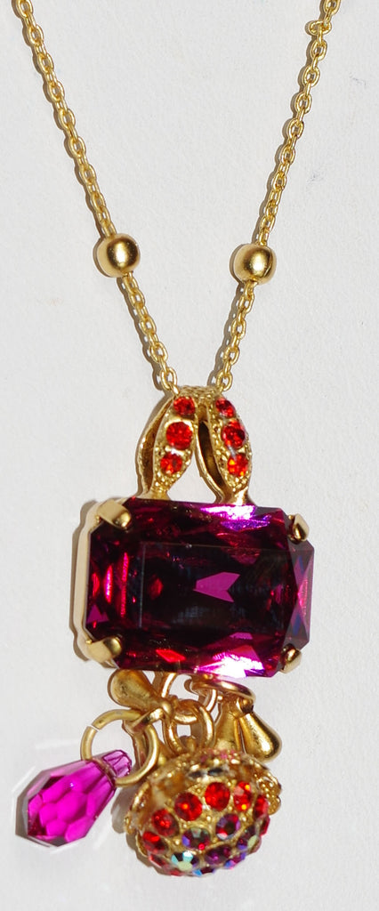 "MARIANA PENDANT LADY MARMALADE: pink, orange stones in 1.5"" yellow gold setting, 28"" adjustable chain"